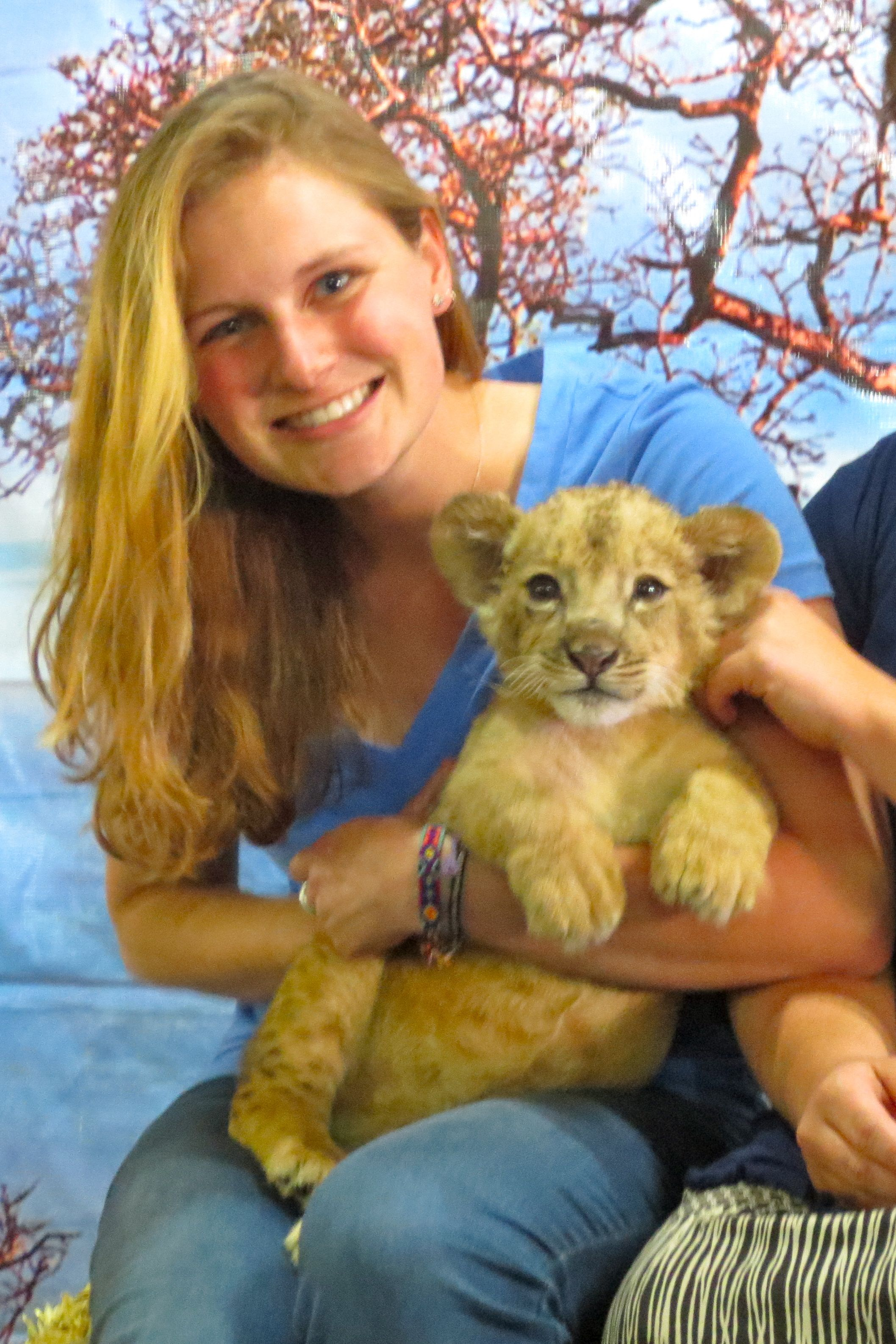 Holding a lion.