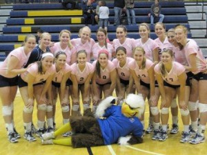 "My volleyball team, and our beloved Eagle, at our annual ""Dig Pink"" game to raise funds for Breast Cancer awareness."