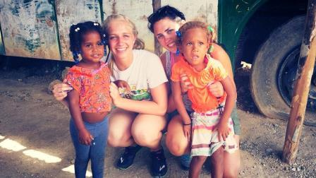 My friend Taylor and I (left) posing with the cutest little girls at Centro Cultural Guanin.