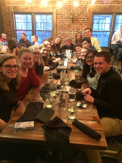 Here's a table of good-looking Writing Center tutors having some fun conversations over dinner at Chatty Monks.